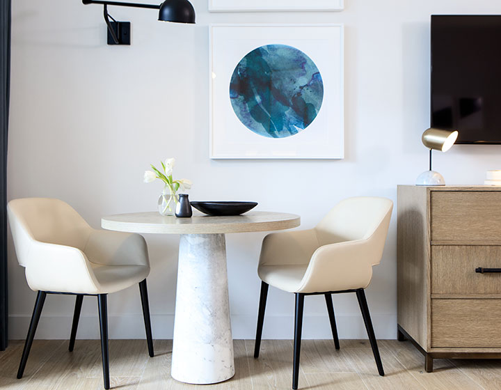 two chairs and a table in a suite