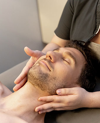 man getting face massage at Exhale